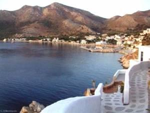 Tilos Livadia Port. The main town (Megalo Horio),  is 8 kilometers northwest of the port.
