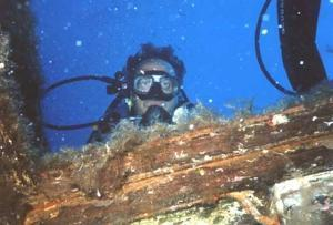 Scuba Diver And Wooden Wreck