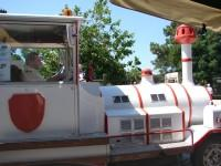 Plaka: While having one's coffee, here is an unexpected encounter; the electrical toy train full with visitors.