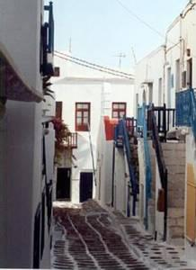 Mykonos Town Alleyway.  Try to distinguish the Chapel on your far right down the hill.  Hint: it has a red roof!